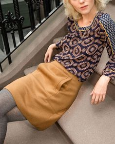 I love this medallion motif. This outfit is exactly my style for work - soft, relaxed blouse on top, delicate layered jewelry, and a pencil skirt with opaque tights. Perfect!