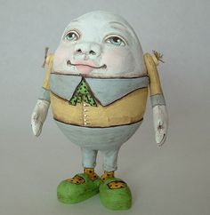 A one-of-a kind piece, Humpty's eggy self is hand sculpted out of paper clay over paper mache without the use of any molds. His arms are made of painted ...