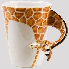 I love Giraffes! It is my all time favorite animal!!!! I could put my nice warm hot coco with 9 marshmellows in it after sledding!!! :)