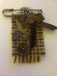 Kilt pin tweed brooch