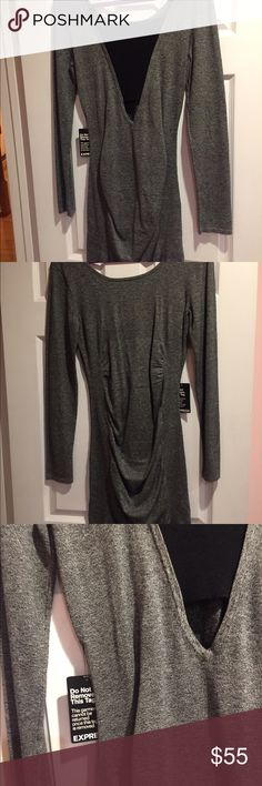 grey bodycon dress Long sleeve, with black detailing on the back. Fits Tight but is not too short Express Dresses Long Sleeve