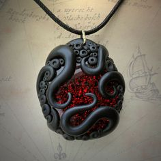 Tentacled Ruby Red Glass Necklace