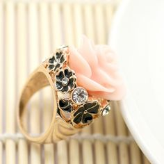 Rose Ring Gorgeous ring with a rose on top.  Flower detail on sides in black with crystal inlay.  Size eight only. Jewelry Rings