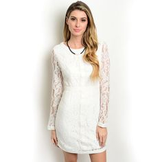 Give your wardrobe a lift with this lace dress from Shop the Trends. This dress has a fashionable lace overlay with a cross detail on the front.