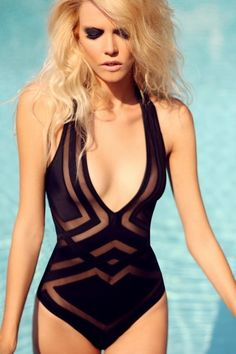 Gorgeous plunging  1-piece suit with mesh cutouts.