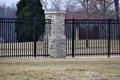 Ornamental Aluminum Fencing with Stone Columns