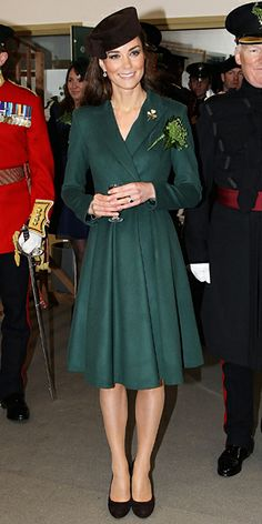 On St. Patrick's Day, Catherine chose the holiday's signature color—green! She wore a coat dress and black belt by Emilia Wickstead and a Lock & Co. hat to present Irish Guard soldiers with shamrocks at Mons Barracks in Aldershot, England. 2012