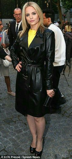 Actress Mena Suvari in a black leather trench coat