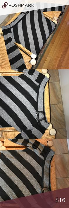 Off the shoulder Black and Grey striped top This lovely off the shoulder top can go well with jeans, a skirt, you name it! In mint condition. Very soft material. Size large but fits like a comfortable medium. Offers are welcome :) Tops