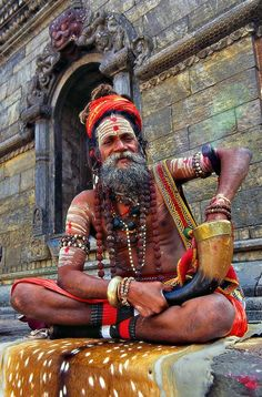 Colors of India - holy man before the temple   Photography of Sergio Pessolano