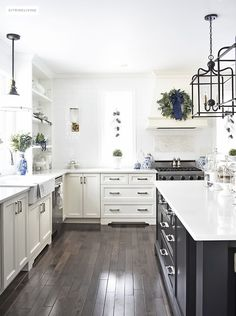 a beautiful christmas kitchen with blue and white chinoiserie paired with holiday greenery for a
