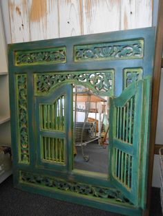 A beautiful mirror painted by Lee Duggan with Chalk Paint® decorative paint by Annie Sloan in Aubusson Blue, English Yellow & Antibes Green | By Stockist Le Anns' Unique Gift Boutique of Tasmania, Australia