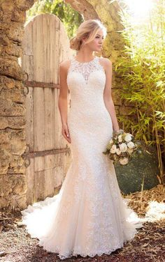 D2174 Lace wedding dress with halter neckline by Essense of Australia. Fit amd flare halter with dropped waist. Court train. Fabric: organza, lace, satin & Embellishments: Lace