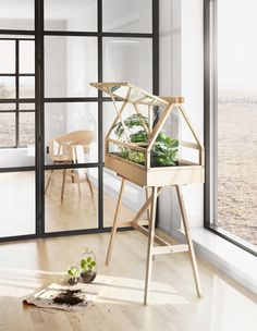 small enough for indoor use but large enough to fit a miniature garden, design house stockholm presents the 'greenhouse' terrarium designed by atelier Miniature Greenhouse, Indoor Greenhouse, Small Greenhouse, Greenhouse Plans, Indoor Garden, Indoor Plants, Greenhouse Wedding, Greenhouse House, Pallet Greenhouse