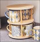 I've seen people looking for ways to store their coffee mugs. This is brilliant, a lazy susan for your coffee mug!
