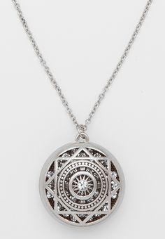 silvertone pendant necklace with shimmering rhinestone interior