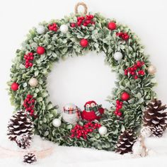 Make this beautiful Christmas wreath to add a festive touch to your home!