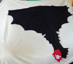 Love this Toothless wings & tail from Etsy.