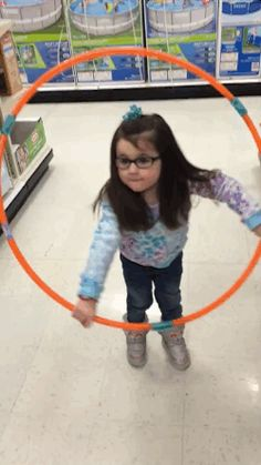 Hailey! This is exactly what hula-hooping feels like. | This Adorable Girl Trying To Hula Hoop Failed So Hard She Won