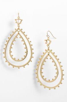 Kendra Scott open drop earrings.