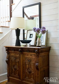 The entry hall in Robert Brown's Lake Hartwell home introduces visitors to a skillful mix of new and old pieces, including a carved oak chest that the designer's father bought at auction long ago.