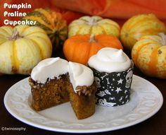 These cupcakes are nice and dense with just the right amount of spice and pumpkin with the added bonus of a pecan praline topping and a light and fluffy cream cheese icing. #cupcakes #pumpkin #halloween #holiday #fall #yum