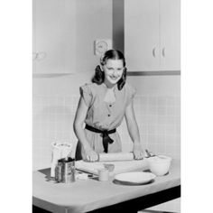 Portrait of woman with rolling pin in kitchen Canvas Art - (24 x 36)