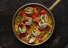 Weeknight Chorizo and Clam Paella. Have a 12-inch skillet, short grain rice, and broth? Then you've got the keys to paella—no special equipment needed. http://gourmet-cookbooks.blackjava-gifts.com/weeknight-chorizo-clam-paella