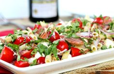 Ingredients: 1 lb Bowtie or other pasta, 1 cup of fresh mozzarella cheese 1 cup pepperoni or hard salami, 1 cup of Roma or grape tomatoes, 1/2 cup marinated artichoke hearts, 1/2 cup of heart of palm, 1/4 cup of green olives, 1/4 cup of roasted yellow or red peppers, 1/4 cup marinated mushrooms, pepperoncinis and basil to taste.   Directions: chop ingredients into bite-sized chunks. Dressing: whisk together 1 cup olive oil, 1/4 red wine vinegar and 1/4 cup balsamic vibegar
