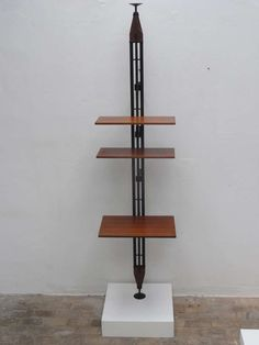 Franco Albini Attributed; Rosewood, Brass and Enameled Steel Shelves, c1956.