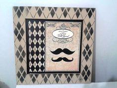 Quadro decorativo tema bigode. <br>Peça decorativa com papel scrap. <br>Técnica em stencil.