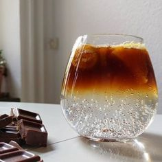Coffee Gin Tonic | Mix 25ml of coffee liqueur with 35ml of your gin of choice. Top with either Fever-Tree Aromatic tonic or normal tonic. Serve in copa glass filled with ice, and garnish with orange zest and a fresh cherry.