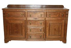 """""""A fine 18th-century oak Welsh buffet incorporating fruitwood and walnut inlay. The breakfront form is constructed with four center drawers flanked by cupboards with a single drawer above them on both sides. The dresser retains an old nutty brown hand-waxed patina and it's 18th-century brass tear drop drawer pulls."""""""