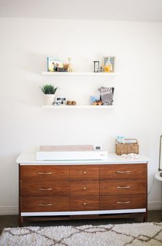 Mid-century modern dresser in gender neutral nursery