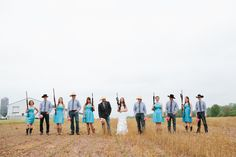 Wedding Photography. Fun Bridal Party Photo. Girls With Guns. Guys With Flowers. Rustic. Country Wedding.