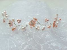 Peach and white fresh water pearl wedding hair vine via TiarasAndTeirs. Click on the image to see more!