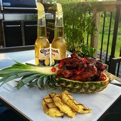 #TropicalTuesday! Spicy pineapple glazed chicken wings with a nice cold beer.  I used half the pineapple, some sugar and lime juice and boiled it down to make the base. Added some butter, apple cider vinegar, soya sauce, hot sauce and red pepper flakes. Dry rubbed and grilled the wings before coating and cooking on the glaze.  Smelled like, tasted like and felt like the tropics tonight! @zimmysnook