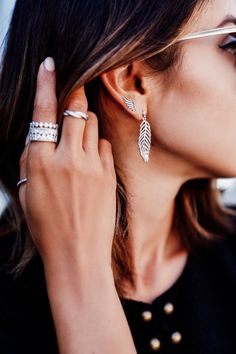 PANDORA rings and feather earrings. Blogger Viva Luxury looks amazing at the PANDORA Jewelry and Nanette Lepore show at New York Fashion Week. #PANDORAatNYFW