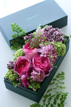 flowers arranged in a box, love this idea