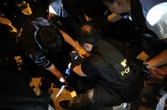 Umbrella Revolution Hong Kong, A Pro-democracy protester is being arrested by riot police forces, after clashing with police at Sai Yeung Choi Street at Mongkok district on November 29, 2014 in Hong Kong, Hong Kong.