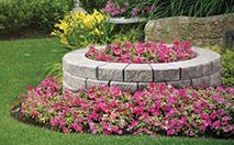 StackStone® / RomanStack® Garden Wall- The StackStone® Collection features a 2-sided finish and the self-aligned, tapered stone design provides a structural interlock making straight walls, curves and corners easy to design and build. Maximum allowable height is 2.0 ft.  RomanStack® offers the same design opportunities but with a Roman textured finish.