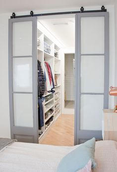 The walk-in closet which leads to the ensuite bathroom was designed by Abel Perez. He found these sliding doors for €15 each from an app called Wallapop, which sells all things second hand. He had them repainted, giving them a new polished look.