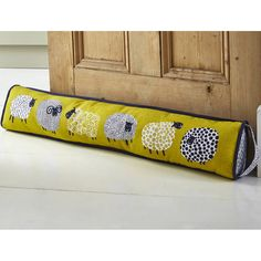 sheep draught excluder - may be triangular shape. 90x14cm cotton with poly wadding and sand.