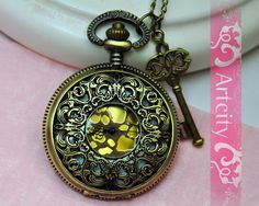 Steampunk Golden Dial Pocket Watch Necklace, with brass Key. $7.50, via Etsy.