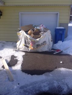 BullBag's can be filled inside garages and car ports when it's cold and snowy or rainy outside. This BullBag was just out of the garage to be emptied.