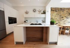 Island kitchen with full height wall of units internally, opens out to extension with face brick internal wall London Open Plan Kitchen Dining, Kitchen Layout, New Kitchen, Kitchen Design, Island Kitchen, Kitchen Ideas, Rear Extension, Extension Plans, Kitchen Diner Extension