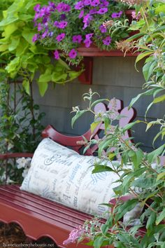 Red bench and blooms around the Potting Shed | homeiswheretheboatis.net #garden #summer