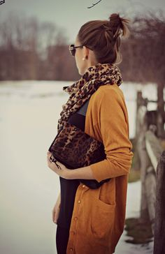 Mustard colored cardigan with animal print for winter.