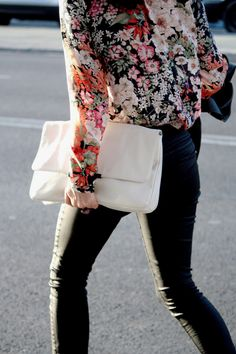Coated dark jeans, shirt pattern, large, white clutch. Yep.