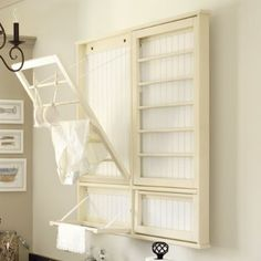 retractable wooden clothes rack:  a bit delicate, but so stylish